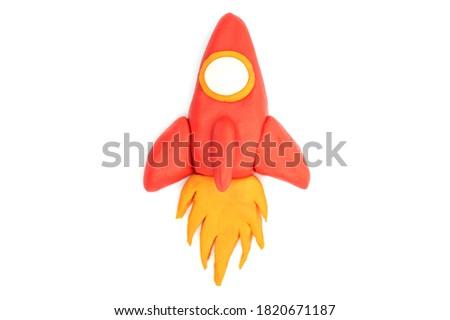 Play dough Rocket on white background. Icon rocket. Handmade clay plasticine