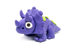 Play dough Triceratopson on white background. Handmade clay plasticine