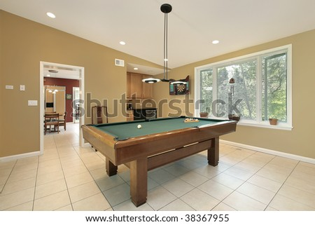 Play room in luxury home with pool table - stock photo