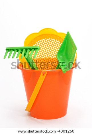 play set with bucket, shovel,filter and rake on white