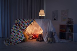 Play tent decorated with festive lights in modern child's room