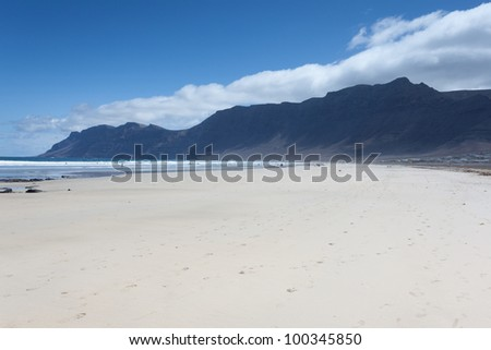 Playa De Famara is a popular beach for surfers on the island of Lanzarote.