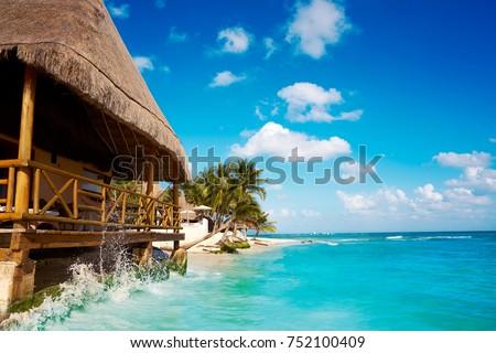 Shutterstock Playa del Carmen beach palapa in Riviera Maya Caribbean at Mayan Mexico