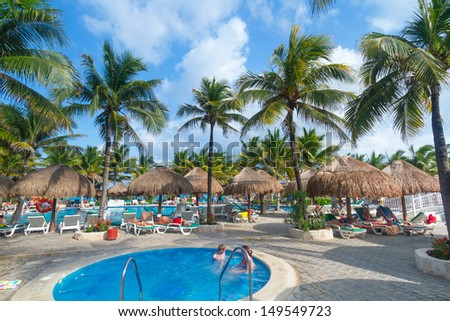 PLAYA DEL CARMEN, MEXICO - JULY 13: Scenery of luxury swimming pool at RIU Yucatan Hotel  in Playa del Carmen on July 13, 2011. RIU Hotels & Resorts has more than 100 hotels in 19 countries.