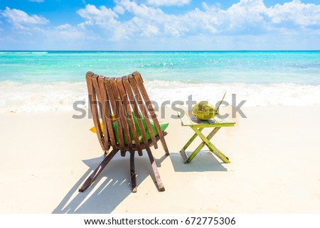 Shutterstock Playa del Carmen - relaxing on chair at paradise beach and city at caribbean coast of Quintana Roo, Mexico