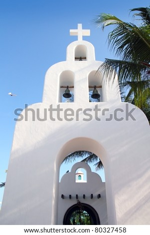 Playa del Carmen white Mexican church with arch and belfry in Mayan Riviera Mexico