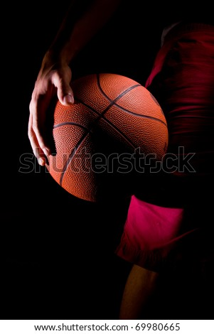 Player Holds a Basketball
