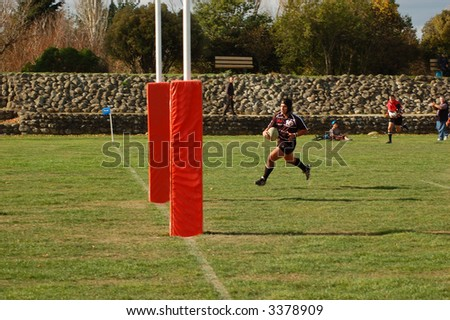player running to score a try (goal) in rugby