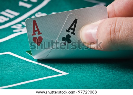 player shows pocket aces