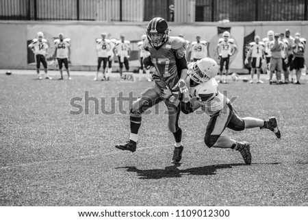 Players of the team in the fight for the ball. American football game.