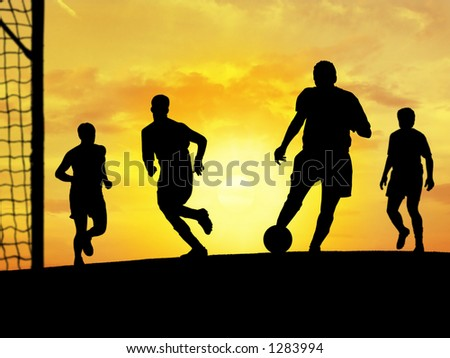 Players playing soccer outdoors.
