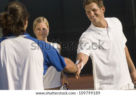 Players shaking hands after tennis match