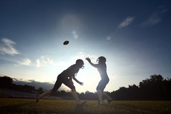 Players women American football fighting for ball.