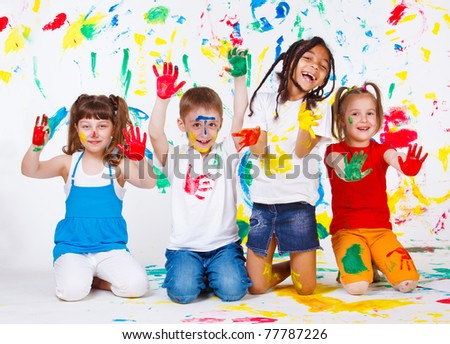 Playful children painted all over