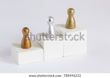 Playful Concepts: Gold, Silver and Bronze gamefigurine on a winner podium #788496232