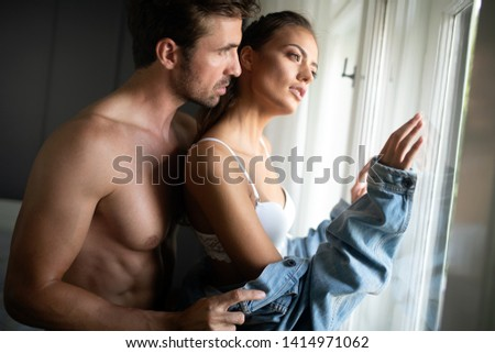 Playful couple in love affectionate in the morning