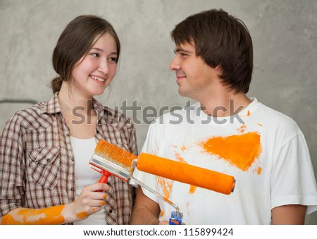Playful couple looking at each other while remodeling