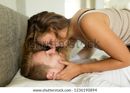 Playful cute couple affectionate in the morning #1236190894