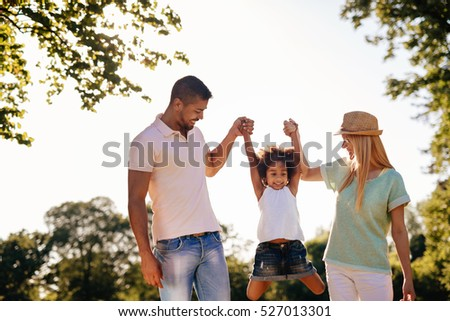 Playful family having fun outdoors and walking #527013301