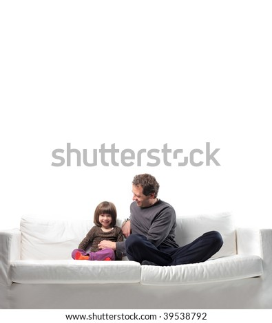 playful father tickling his little daughter