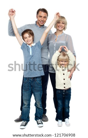 Playful kids with parents over white background, raising hands.