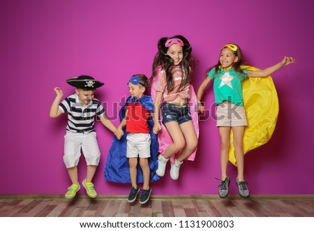 Playful little children in cute costumes indoors #1131900803