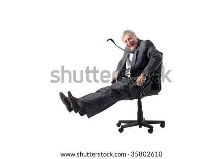 playful senior businessman running on manager armchair