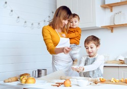 Playful siblings helping to mom cooking pie or dessert. Teaching kids, hobby and pastime concept.