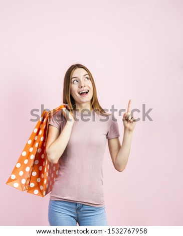 Playful woman in jeans with pink background #1532767958