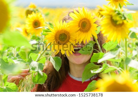 Playful woman in sunflower field. Summer background #1525738178