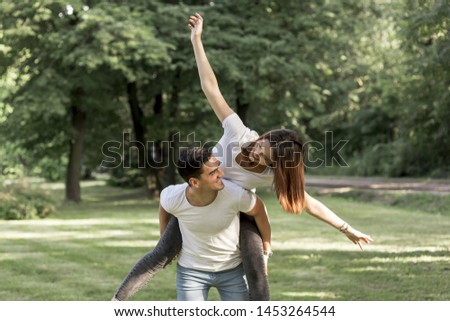 Playful woman looking at her boyfriend #1453264544