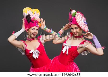 Playful women in original hats and dresses shot #1492642658