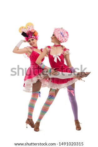 Playful women in original hats and dresses view #1491020315