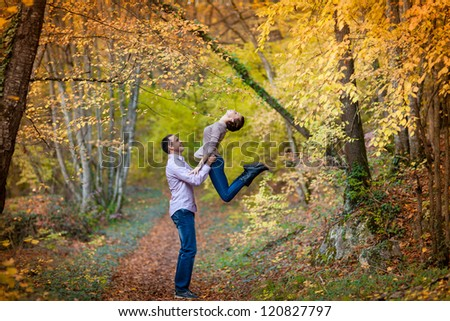 playful young couple in love having fun enjoy a moment of happiness on nature. handsome guy and beautiful brunette woman enjoying spring holiday together. Loving couple on date in park looking happy