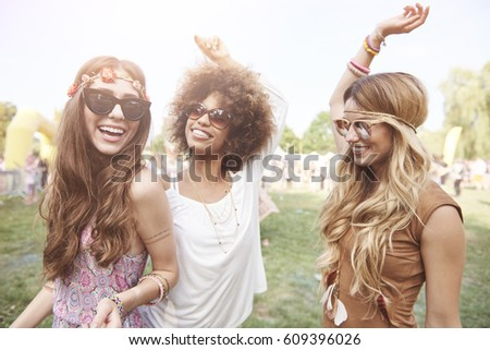 Playful young girls at summer festival