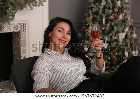 playful young woman celebrates christmas