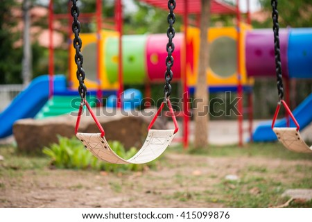 Playground and swings in colorful park