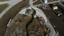 Playground in the park. Aerial view of the construction site. Construction site from the air.