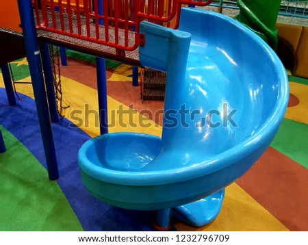 Playground indoors curved slide for kids #1232796709
