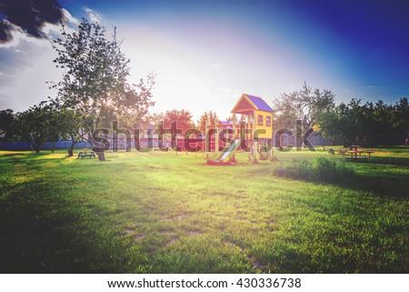 playground of children's near a house. vintage photo