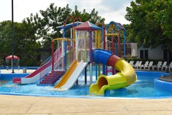 Playground with a swimming pool. water Park for children. colorful sports facilities autdoor games