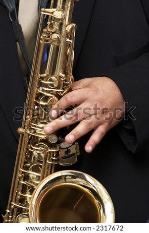 Playing a brass horn - musical instrument - stock photo