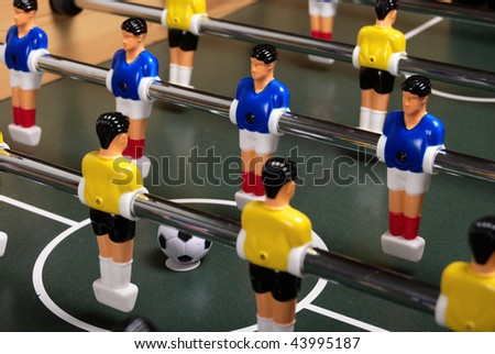 Playing a table soccer