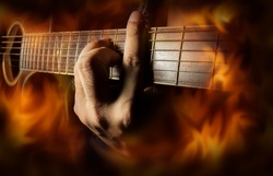 Playing acoustic guitar with fire flame screen.