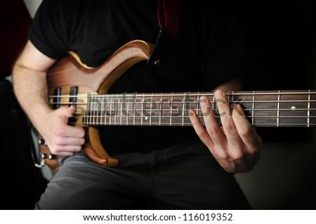 Playing Bass Guitar #116019352