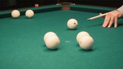 Playing billiards. Clip. Blowing a cue on the ball, the ball hit the pocket, the ball did not hit the pocket, billard, green table, breaking balls, muffled light, billiard club
