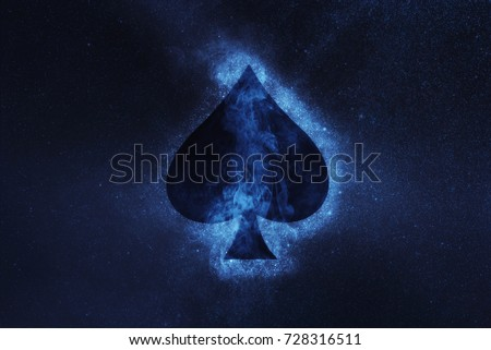 Photo of  Playing card. Spade symbol. Abstract night sky background