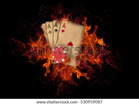 playing cards and chips on fire....