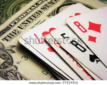 Playing cards and dollars.