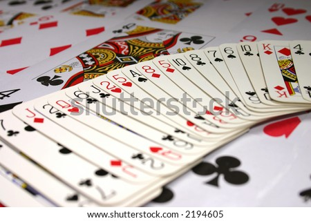 Playing cards background with focus on the Ace of Spades.